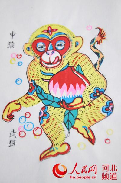 图为武强木版年画传人康英勤为猴年设计的年画图片